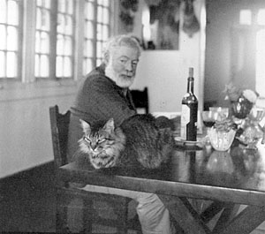 Ernest Hemingway with one of his many cats at Finca Vigía. (JFK PRESIDENTIAL LIBRARY, BOSTON)